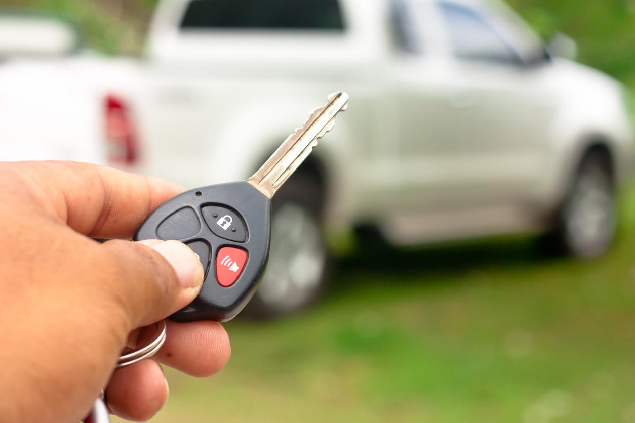 Close up Hand holding car key